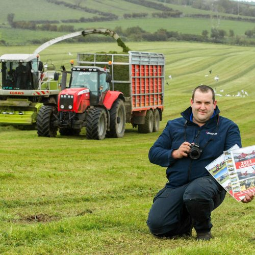 Steven Evans from Kirkistown, with a 2021 Calendar showcasing his photography of agricultural contractors operating around the Ards Peninsula, the sales of which will be donated in full, to the Air Ambulance NI.